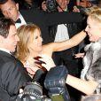 Sharon Stone, John Travolta et Kelly Preston se saluent à la soirée Roberto Cavalli sur son yacht sur le port de Cannes lors du 67e Festival de Cannes le 21 mai 2014.
