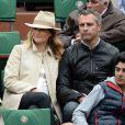Astrid Bard et Yann Delaigue lors du quatrième jour des Internationaux de France à Roland-Garros, le 28 mai 2014 à Paris