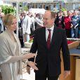 Le prince Albert II de Monaco et son épouse la princesse Charlene ont visité la ville de Carlat où ils ont dévoilé la plaque de l'école Nelson Mandela et ont également visité la ville de Calvinet dans l'ancien Comté de Carladès, le 15 mai 2014.