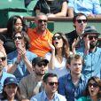 Amel Bent et son ami, Louise Monot et son compagnon, Sofia Essaïdi et son compagnon Adrien Galo lors des Internationaux de France de tennis de Roland-Garros à Paris, le 5 juin 2014.
