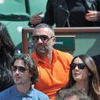 Amel Bent et son ami avec Sofia Essaïdi et son compagnon lors des Internationaux de France de tennis de Roland-Garros à Paris, le 5 juin 2014.