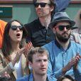 Sofia Essaïdi et son compagnon Adrien Galo lors des Internationaux de France de tennis de Roland Garros à Paris, le 5 juin 2014.