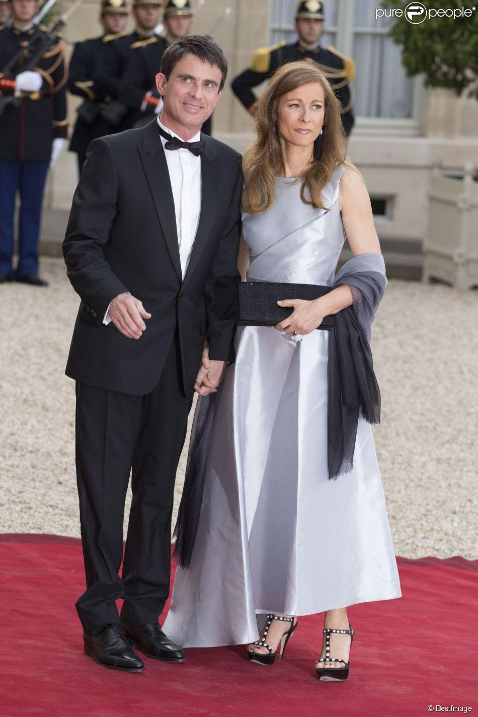 Manuel Valls et sa femme Anne Gravoin lors du banquet à l'Elysée donné en l'honneur de la reine Elizabeth II, Paris, le 6 juin 2014.