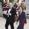 Hubert Védrine et sa femme lors du banquet à l'Elysée donné en l'honneur de la reine Elizabeth II, Paris, le 6 juin 2014.