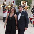 Xavier Darcos et sa femme Laure lors du banquet à l'Elysée donné en l'honneur de la reine Elizabeth II, Paris, le 6 juin 2014.