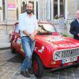 """Kad Merad, Christophe Girard (maire du 4e) - Vernissage de l'exposition """"Les vacances du petit Nicolas"""" à la mairie du 4ème à Paris le 18 juin 2014."""