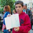 """Exclusif - Nathan, fier de sa dédicace de Sempé - Vernissage de l'exposition """"Les vacances du petit Nicolas"""" à la mairie du 4ème à Paris le 18 juin 2014."""