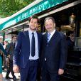 Guillaume Sarkozy et son fils Frédéric lors du déjeuner Père & Fils, mardi 24 juin 2014, aux Deux Magots à Paris.