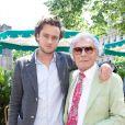 Le photographe Jean-Daniel Lorieux et son fils Nicolas lors du déjeuner Père & Fils, mardi 24 juin 2014, aux Deux Magots à Paris.