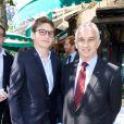 Alain Terzian et son fils Anton lors du déjeuner Père & Fils, mardi 24 juin 2014, aux Deux Magots à Paris.