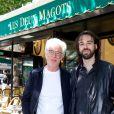 Yves Gastou et son fils Victor lors du déjeuner Père & Fils, mardi 24 juin 2014, aux Deux Magots à Paris.