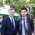 Jean-Pierre Lecoq et son fils lors du déjeuner Père & Fils, mardi 24 juin 2014, aux Deux Magots à Paris.