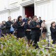 Les enfants de Benoît Duquesne et son épouse Elisabeth unis dans la douleur à ses obsèques, à l'église Jeanne d'Arc de Versailles, le jeudi 10 juillet 2014.