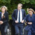Anne Fauconnier, Fabien Namias et Catherine Nay assistent aux obsèques de Benoît Duquesne, à l'église Jeanne d'Arc de Versailles, le jeudi 10 juillet 2014.