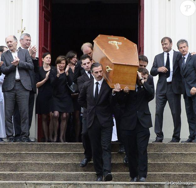 Emotion aux obsèques de Benoît Duquesne, à l'église Jeanne d'Arc de Versailles, le jeudi 10 juillet 2014.