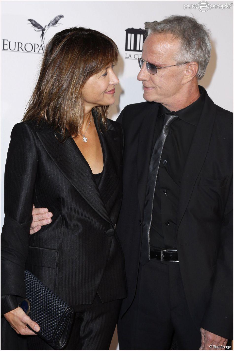 Sophie Marceau & Christophe Lambert, complices lors de la soirée d'inauguration de la Cité du Cinéma à Saint Denis, en France, le 21 septembre 2012. Le couple a annoncé sa séparation le 11 juillet 2014 par communiqué.
