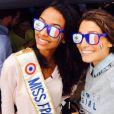 Laury Thilleman et Flora Coquerel complices. Les deux Miss lors du match de la coupe du monde de football qui a opposé la France à l'Allemagne. Vendredi 4 juillet 2014.