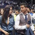 Cristiano Ronaldo et sa compagne Irina Shayk assistent à un match de basket à Madrid, le 20 mars 2014.
