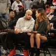 Chris Brown et Karrueche Tran assistent au match de basketball opposant les États-Unis à la République Dominicaine au Madison Square Garden. New York, le 20 août 2014.