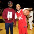 Rihanna assiste à un match caritatif de basketball à New York auquel Chris Brown participe, le 21 août 2014.