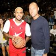 Derek Jeter - Rihanna assiste à un match caritatif de basketball à New York auquel Chris Brown participe, le 21 août 2014.