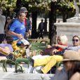 Nicolas Sarkozy en train de faire son jogging avec ses gardes du corps au jardin des Tuileries, le 10 septembre 2014, à Paris.