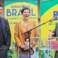 """Rai et Cristina Cordula lors de l'inauguration du Grand Carnaval brésilien """"Sensacional Brasil"""" au Jardin d'Acclimatation à Paris, le 12 avril 2014."""
