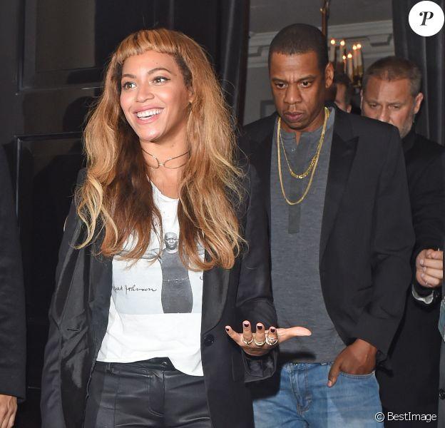 Beyoncé Knowles et Jay-Z quittent un restaurant à Londres le 14 octobre 2014.
