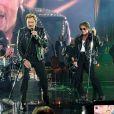 Eddy Mitchell, Johnny Hallyday et Jacques Dutronc en blouson de cuir - Premier concert des Vieilles Canailles au Palais Ominisports de Paris Bercy, le 5 novembre 2014.
