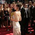 Evangeline Lilly les cheveux délicatement relevés. Elle charme tout le monde...