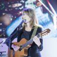 Carla Bruni - Dîner LINK pour les 30 ans de AIDES au Palais d'Iéna à Paris le 8 décembre 2014. LINK est un fonds de dotation créé par des femmes et des hommes, dirigeants de tous horizons qui ont choisi de se rassembler pour que soit gagnée la bataille contre le sida. Lors du dîner, Carla Bruni à donné un concert très émouvant.