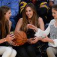 Les trois filles de Sylvester Stallone, Sistine, Sophia et Scarlet lors d'un match de basket des Lakers à Los Angeles, le 7 décembre 2014.