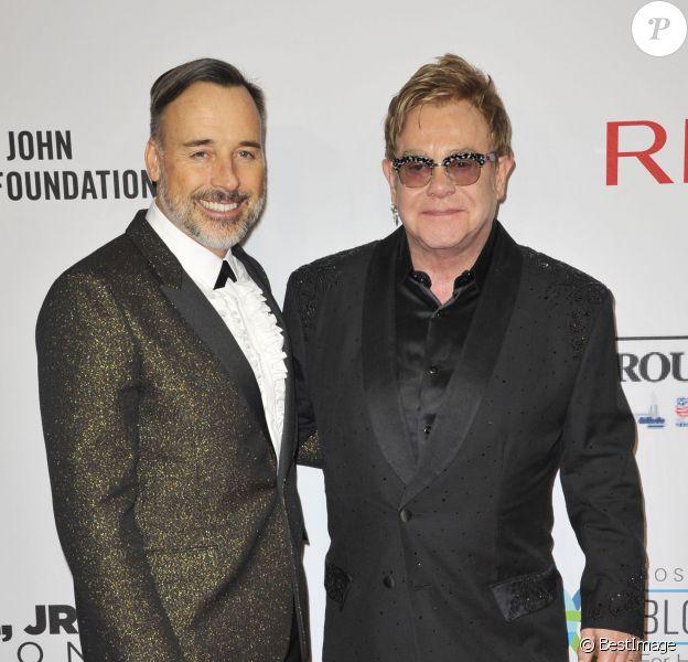 David Furnish et Elton John - People au gala AIDS Foundation à New York. Le 28 octobre 2014