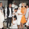 Exclusif - Johnny Hallyday, Laetitia, Jade, son parrain Jean-Claude Darmon et sa marraine Hélène Darroze - Baptême de Joy Hallyday en Suise en 2009.