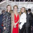 Delphine Arnault, Eva Herzigova et Natalia Vodianova assistent au défilé Christian Dior haute couture printemps-été 2015 au musée Rodin. Paris, le 26 janvier 2015.