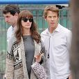 """Julia Roberts gets to work on her new film, """"The Secret in Their Eyes"""" in Pasadena along with co-star Chiwetel Ejiofor in Calabasas, Los Angeles, CA, USA on January 29, 2015. The actress, whose stomach looked a bit bigger than usual, tried to take cover behind a couple of umbrellas while on set and her husband, Daniel Moder, was also there to show his wife some moral support. Could Julia be pregnant with another child or could it be part of her role. Photo by GSI/ABACAPRESS.COM30/01/2015 - Los Angeles"""