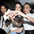 Kendall Jenner et Cara Delevingne lors du défilé Topshop Unique automne-hiver 2015-2016. Londres, le 22 février 2015.