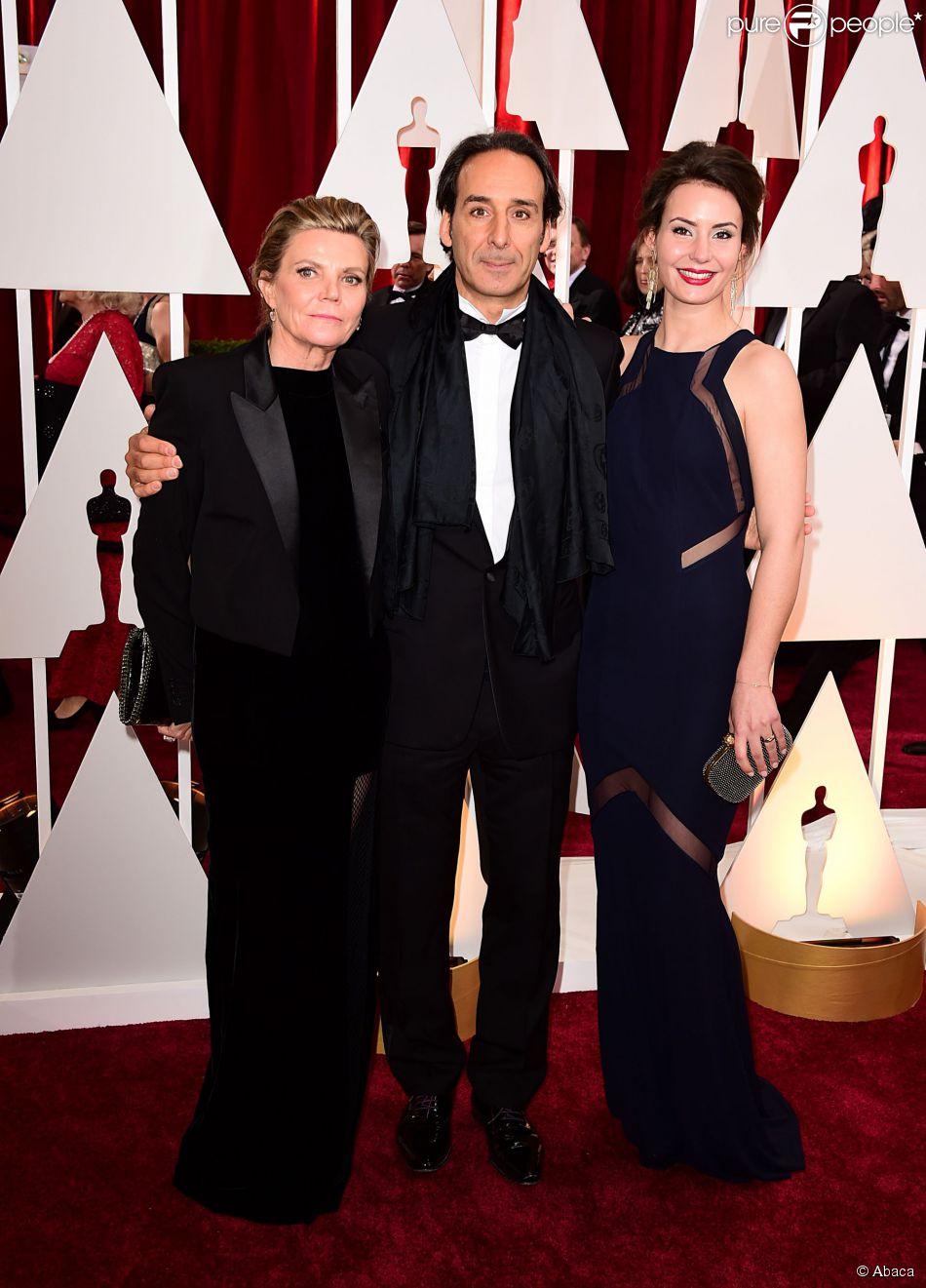 Alexandre Desplat, Dominique LeMonnier et leur fille lors de la 87e cérémonie des Oscars à Los Angeles le 22 février 2015