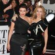 """Dannii Minogue et sa soeur Kylie Minogue arrivant à la soirée des """"Brit Awards 2014"""" en partenariat avec MasterCard à Londres, le 19 février 2014."""