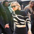 Jennifer Lawrence habillée en Dior se rend dans les locaux de la marque à New York le 21 mars 2015