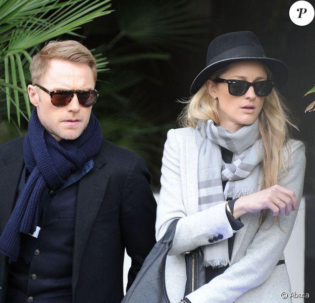 Ronan Keating et Storm Uechtritz quittent les studios ITV à London, le 3 mars 2015