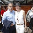 Patrice Dominguez et son épouse Cendrine au tournoi de Roland-Garros à Paris, le 30 mai 2012.