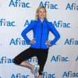 "Kelly Rutherford lance la campagne de ""Aflac Yoga"" à New York, le 9 octobre 2014."