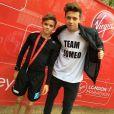 Romeo Beckham soutenu par sa famille, son père David, la mère Victoria et ses frères Brooklyn et Cruz Beckham pour sa première participation au mini-marathon de Londres, le 26 avril 2015.