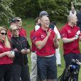 Zara Phillips et Mike Tindall lors de la 3e édition du tournoi de golf caritatif ISPS Handa Celebrity Golf Classic le 8 mai 2015 à The Grove, dans l'Hertfordshire.