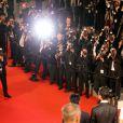 """Photographes devant Zhang-Ke Jia, Sylvia Chang, Zijang Dong, Jindong Liang - Montée des marches du film """"Shan He Gu Ren"""" (Mountains May Depart) lors du 68e Festival International du Film de Cannes, à Cannes le 20 mai 2015."""