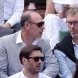 Alain Boghossian et Laurent Blanc lors des Internationaux de France à Roland Garros, le 28 mai 2015 à Paris