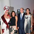 La princesse Stéphanie de Monaco, le prince Albert II de Monaco, la princesse Caroline de Hanovre le 10 juillet 2015 au Sporting de Monte-Carlo lors du gala annuel au profit de l'association Fight Aids Monaco, présidée par la princesse Stéphanie de Monaco.