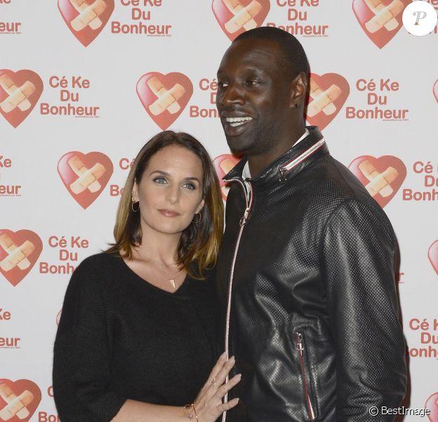 """Omar Sy et sa femme Hélène - Avant-Première du film """"Samba"""" au Gaumont Champs-Elysées Marignan à Paris pour l'association """"Cé Ke du Bonheur"""" à Paris le 14 octobre 2014."""