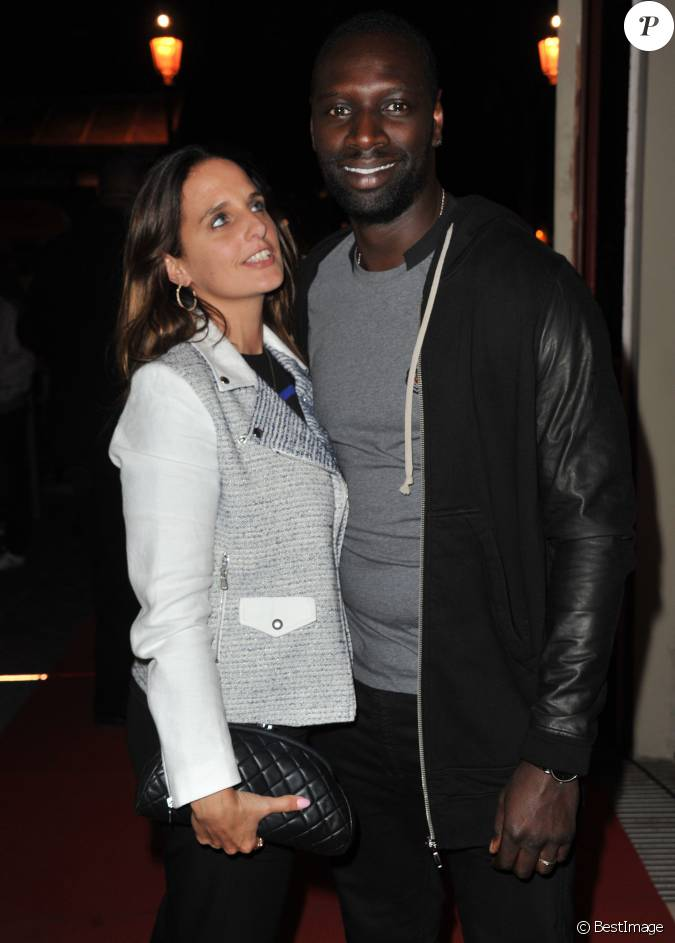 omar sy et sa femme h l ne soir e pour la sortie du jeu fifa 14 paris le 23 septembre 2013. Black Bedroom Furniture Sets. Home Design Ideas